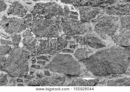 old uneven texture and abstract background of an ancient stone wall