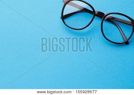 Brown-rim eyeglasses in empty background