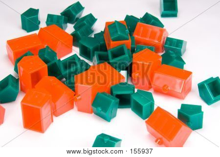 Pile Of Green And Red Plastic Houses