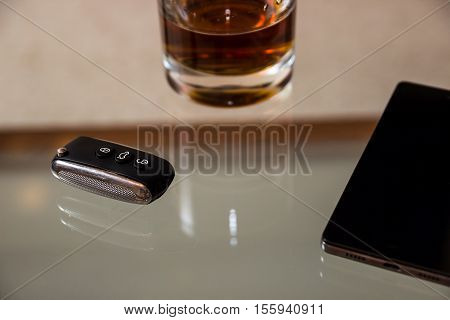 Drunk driving - the cause of car accidents. Drink and keys.
