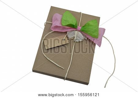 Brown wrapping paper tied with a bow green and pink, Nature paper and notes Isolated in white with path.