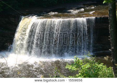 Large Waterfall, Water Crashing Over A Tall Waterfall