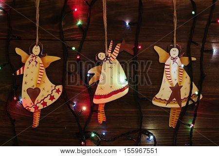 Christmas tree toys angel. christmas decoration handmade toy Angel. christmas decoration handmade toys hanging over rustic wooden background.