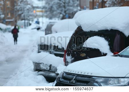STOCKHOLM SWEDEN - NOV 10 2016: Snow chaos in the traffic in central Stockholm. Cars covered with snow November 10 2016 in Stockholm Sweden
