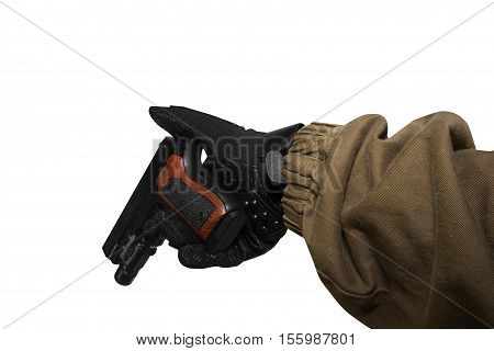 Isolated first person view soldier hand in black battle gloves & tactical jacket holding a reloaded gun.