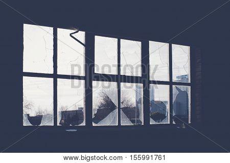 Broken glass at Window of old industrial urbex building