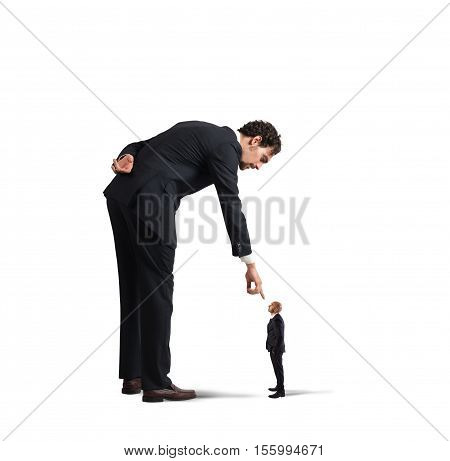 Big businessman looking and pointing a small man