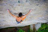 Постер, плакат: Male Sports And Climbs On The Rock