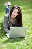 image of native american ethnicity  - A shot of a beautiful ethnic college student working on her laptop on campus - JPG