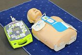 image of defibrillator  - Automated External Defibrillator with training dummy mannequin - JPG