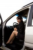 young business woman smile and sit in the car
