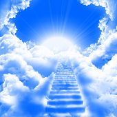 image of stairway to heaven  - a ladder directed up to blue cloudy skies and sun - JPG