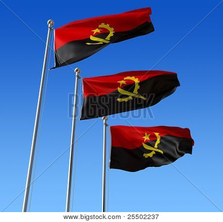 Three flags of Angola against blue sky.