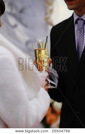 Bride And Groom Holding Wedding Champagne