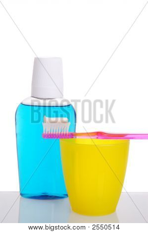 Toothbrush On Cup With Mouthwash