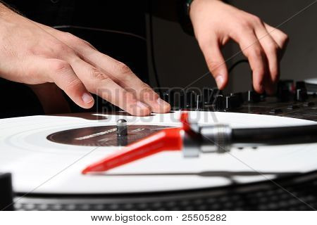 Hands Of A Dj Playing Music From Vinyl