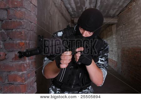 Soldier In Black Mask Targeting With A Gun