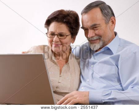 Senior Couple On Laptop