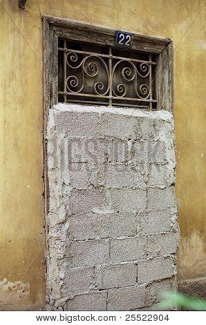 Vintage Door Blocked By Concrete Blocks
