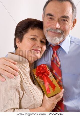 Derly Happy Couple With Gift