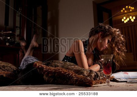 Woman Lying On A Fur Mat