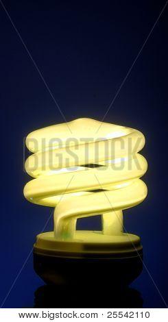 white light bulb on blue background