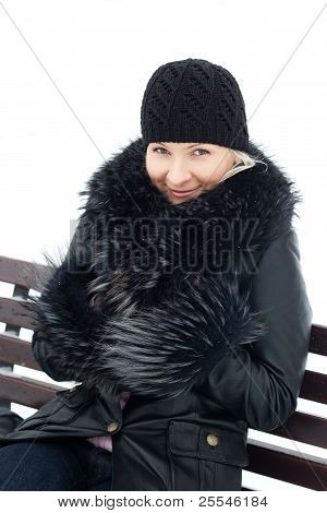 Young Blond Woman Outdoor Winter Portrait On Bench.