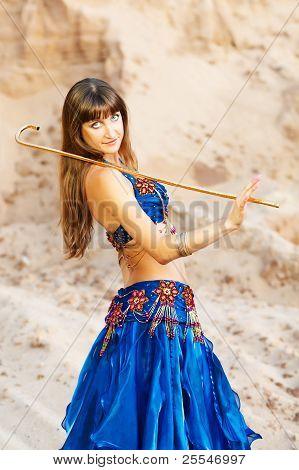East Belly Dancer In Blue Lingerie With Gold Can.