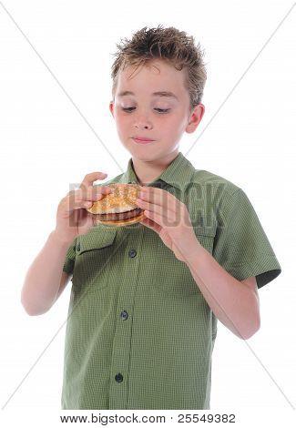 Little boy eating a hamburger