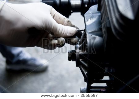Mechanic Fixing An Engine