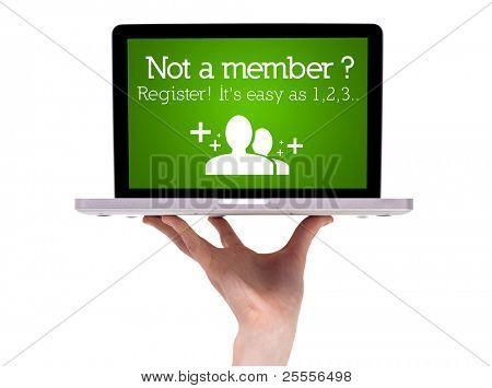 Mão segurando laptop com sinal de registo