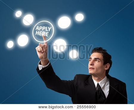 """Business man pressing a """"Apply HERE"""" button."""