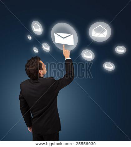 business man pressing e-mail button