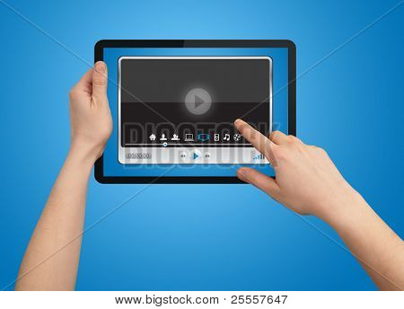 A male hand holding a touchpad media player state of the art