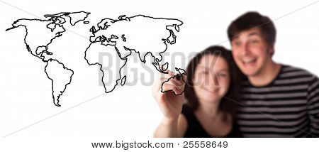 A picture of a young couple drawing a world map over white background