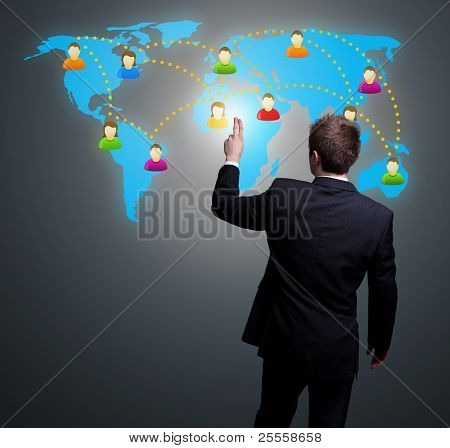 Businessman hand pressing Social network icon