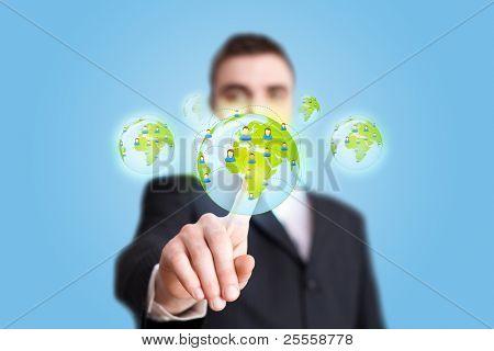 Businessman hand pressing Social network icon