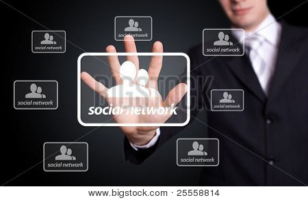 Businessman hand pressing Social network sign