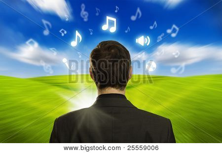 Young businessman with icons floating around his head 2