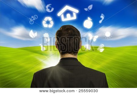 Young businessman with ECO icons floating around his head