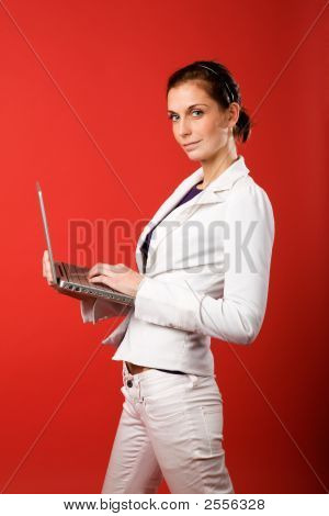 Female With Computer On Red