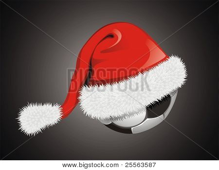 soccer ball in hat of Santa Klaus