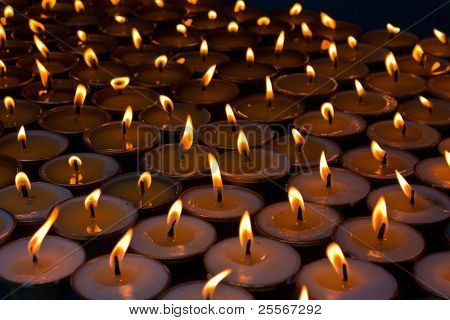 Burning candles at a Buddhist temple