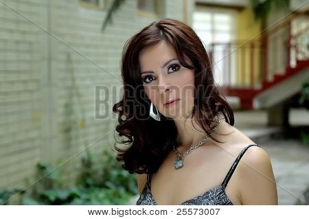 Portrait of the brunette with a charming sight