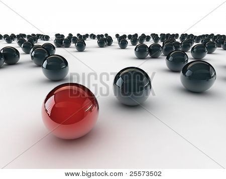 One unique red ball, among other black