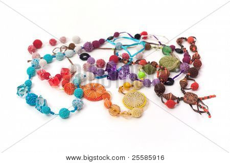 Abstract composition of beads, chain, pendant, isolated on white background