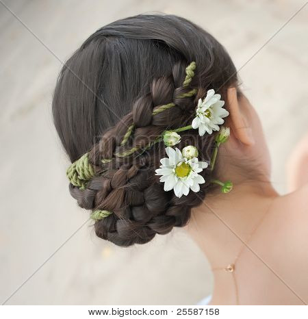 back view of beautiful haircut with small flowers