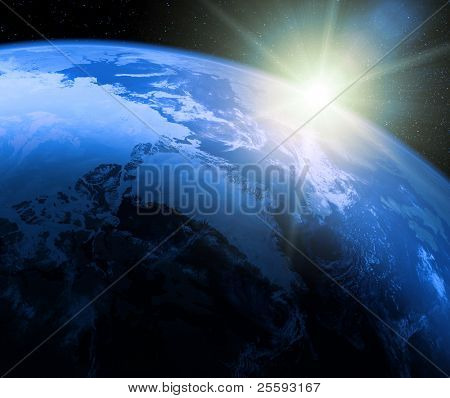 Planet earth with sunrise in space
