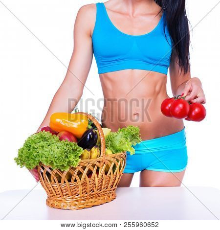 poster of Portrait of slim fitness cherrful girl in studio with set of fruit and vegetables over white backgro