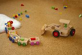 stock photo of children playing  - Some wooden toys lying on the floor - JPG